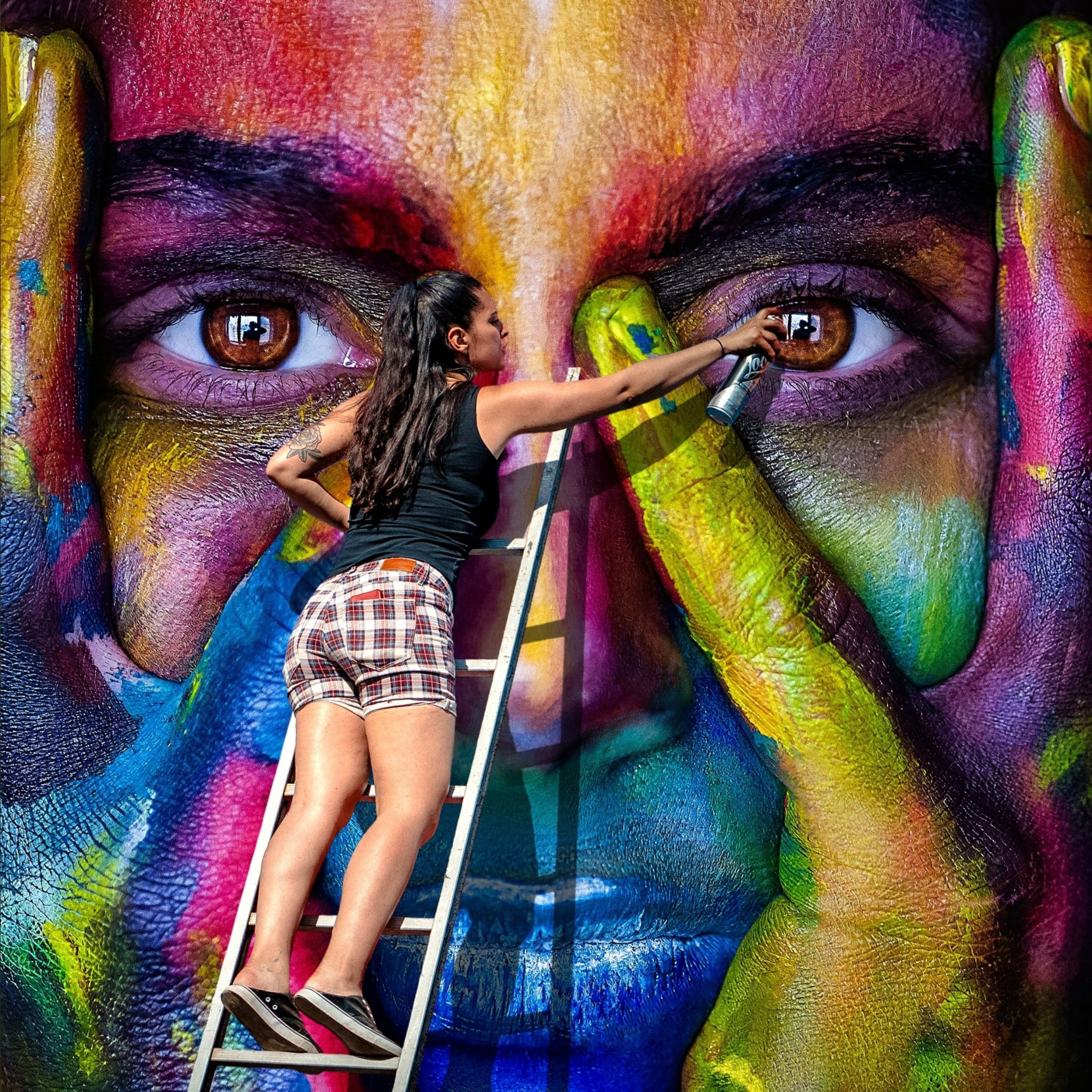 Girl painting a face